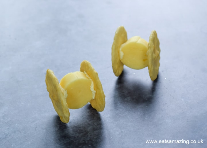 How to make Star Wars cheese and cracker TIE Fighters - step 4 turn over and balance on the cracker edges