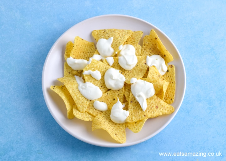 How to make nachos in the microwave - step 2 dollop over sour cream