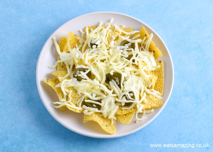 How to make nachos in the microwave - step 4 top with grated cheese