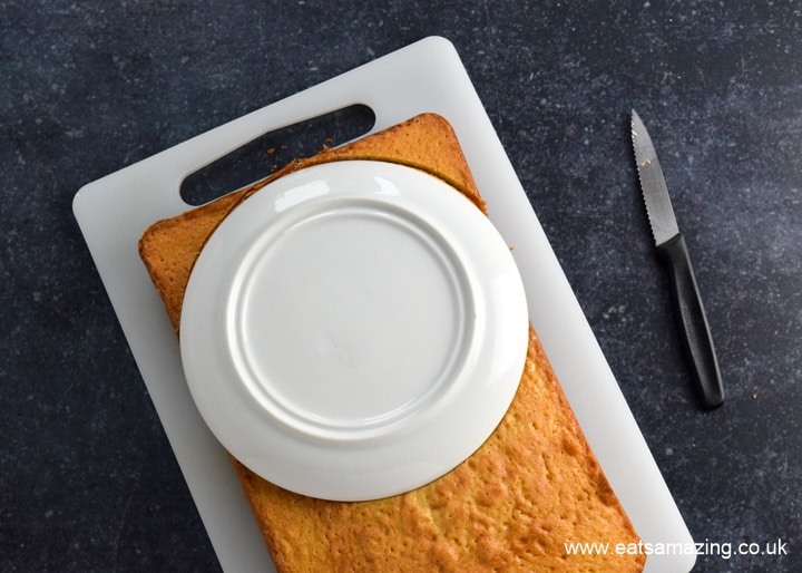 How to make an easy Among Us Crewmate Cake - step 2 use a plate as a template to cut around for the curved top