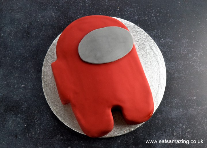 How to make an easy Among Us Crewmate Cake - step 8 roll out a grey oval for the base of the visor