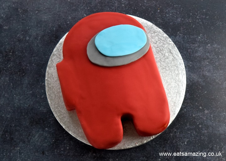 How to make an easy Among Us Crewmate Cake - step 9 roll out a slightly smaller pale blue oval