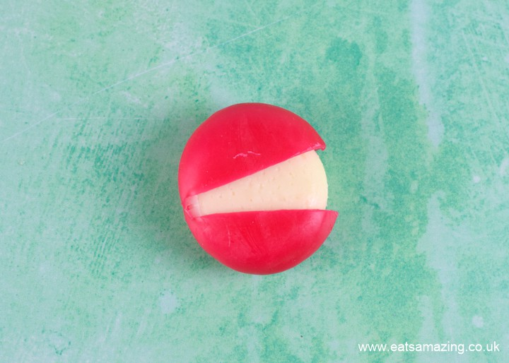 How to make babybel cheese monsters - step 2 pull wax apart to make mouth