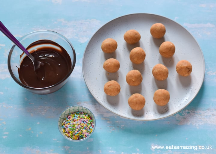 How to make chocolate covered cake balls - easy recipe step 5 dip cake balls in chocolate and add sprinkles