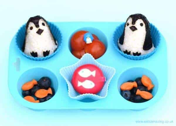 Cute penguin themed muffin tin meal for a toddler with rice penguins made using the baby penguin rice mould set from Eats Amazing UK