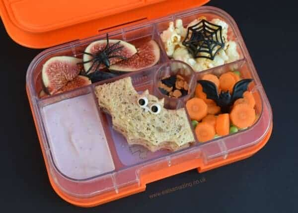 Easy Halloween lunch idea for kids in the Yumbox UK bento box with bat snadwiches from Eats Amazing UK