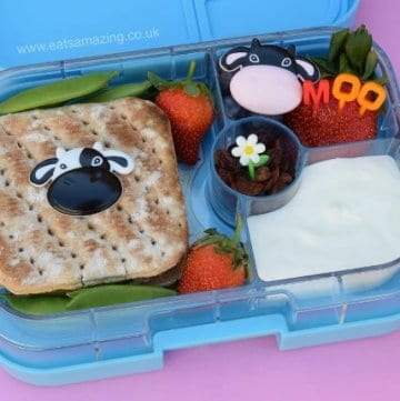 Easy bento lunch ideas for kids - simple and healthy cow themed lunch in the Yumbox Panino - with cupcake picks and bento picks to decorate - Eats Amazing UK