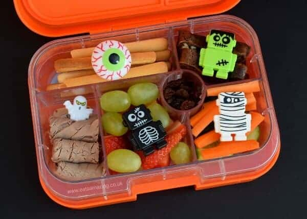 Simple Halloween bento lunch for kids in the orange Yumbox bento box from Eats Amazing UK