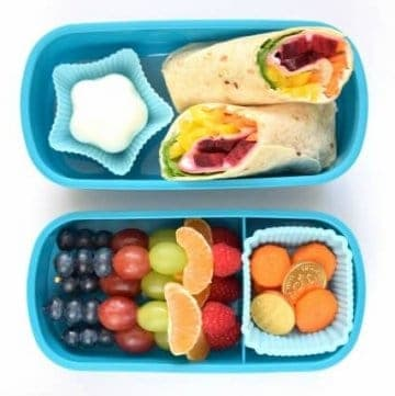 Step by step simple and healthy rainbow bento lunch idea for kids with rainbow tortilla wrap recipe and rainbow fruit skewers from Eats Amazing UK