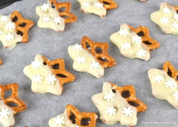 Super simple snowflake pretzels recipe - a yummy nutcracker party food idea from Eats Amazing
